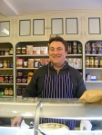 Carl Bennett behind the counter at Yoxford Post Office